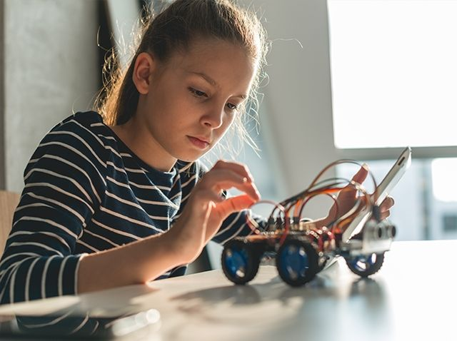 young girl with robotics model
