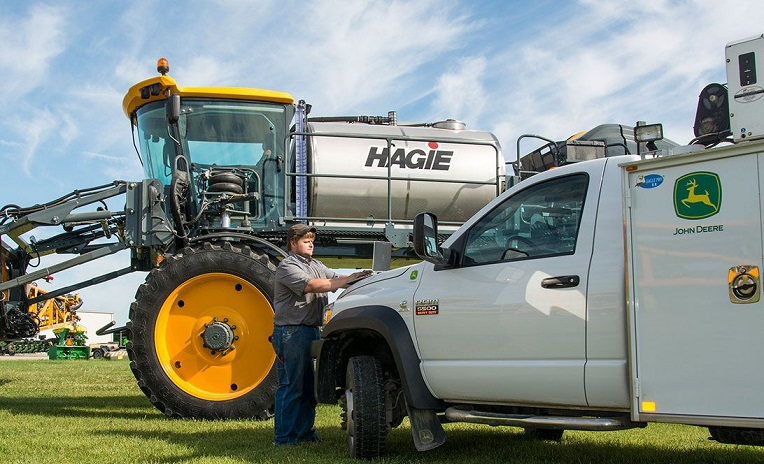 man with Hagie and Deere truck